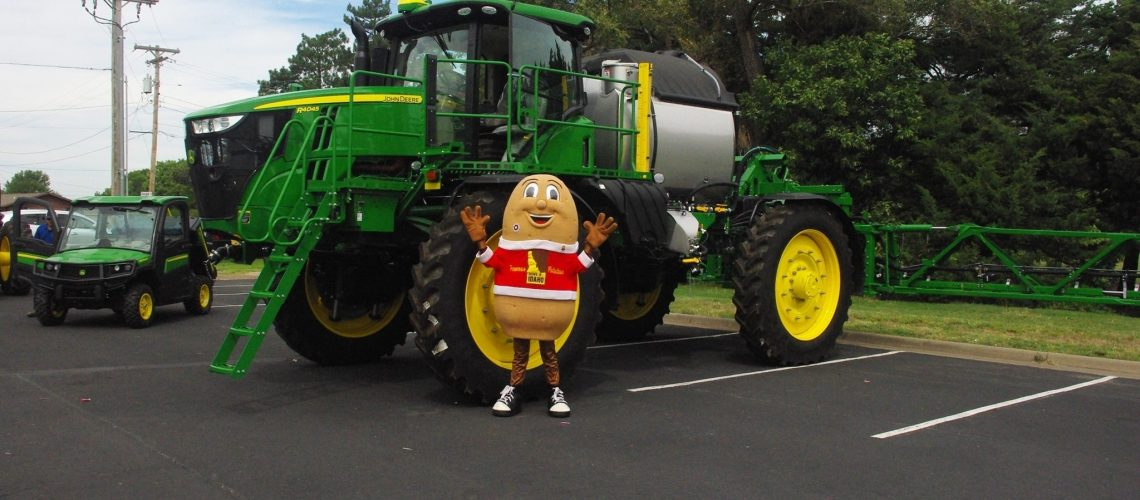 Spuddy Buddy with a John Deere at Touch-A-Truck!